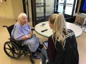 Health care volunteer surveys rehabilitation resident