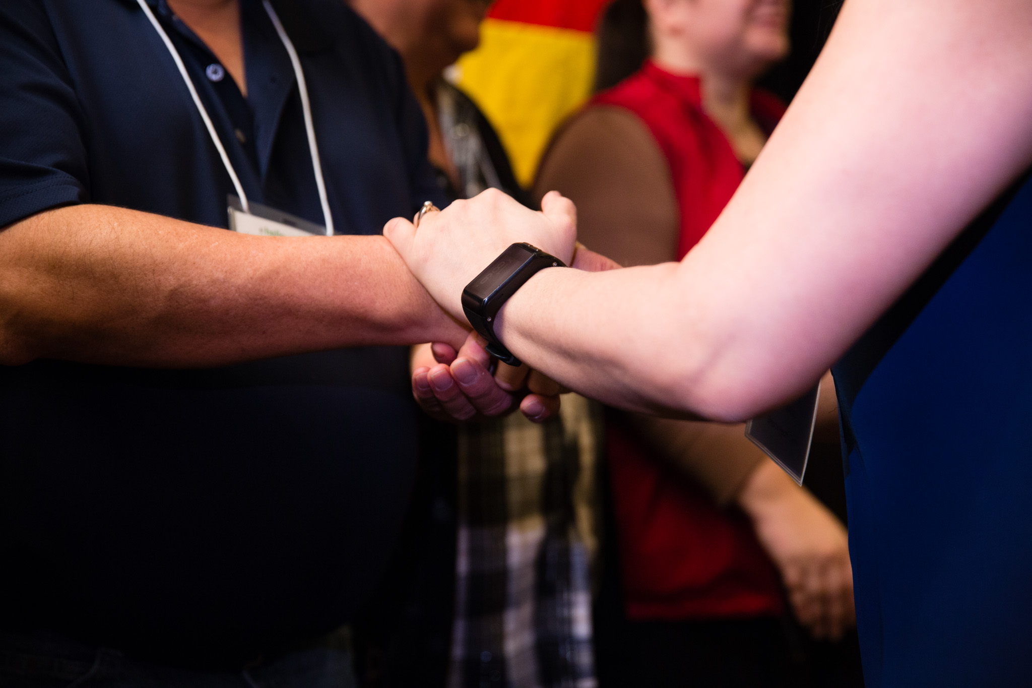 A close up of people shaking hands at the BC Quality Forum