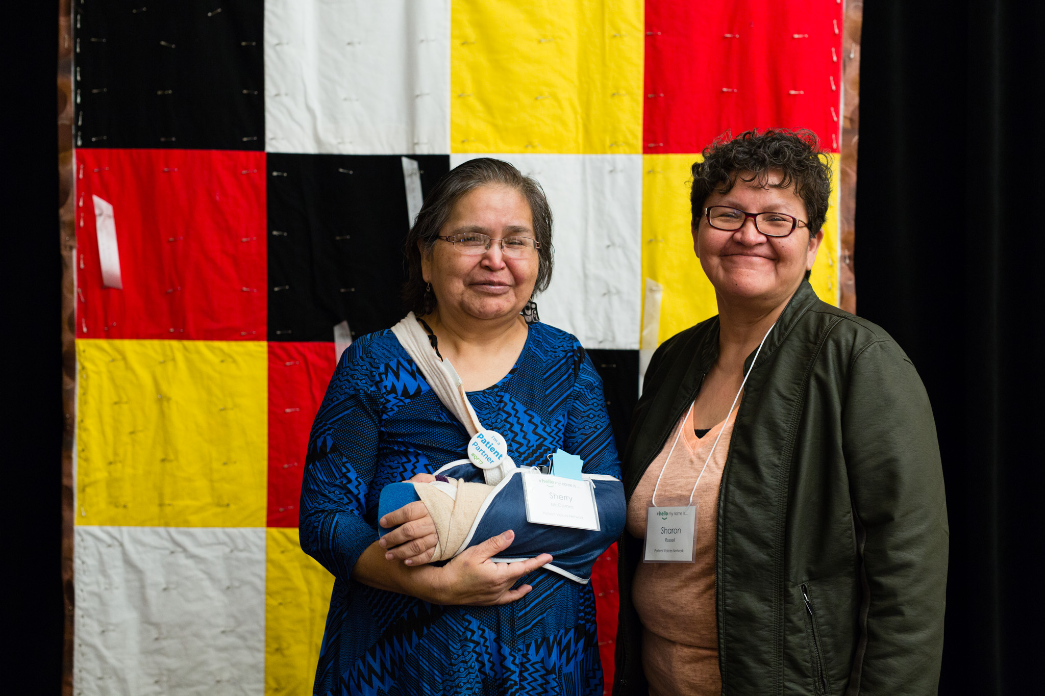 Two women pose for a photo at the BC Quality Forum.